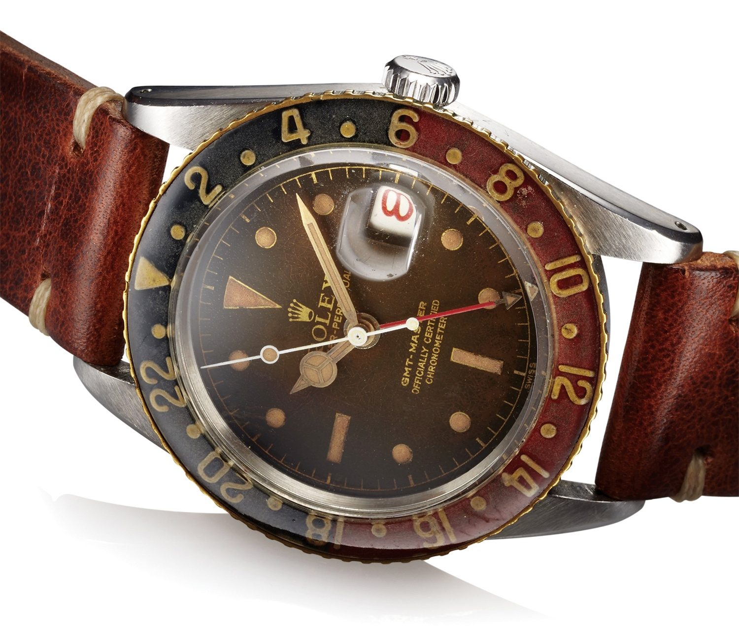 This Antiquorum lot Rolex Ref. 6542 GMT with Gilt Tropical Dial in Steel up for auction in June still retains its original Bakelite bezel and the dial has turned a beautiful brown color. Estimated auction price: $15,000 - $35,000